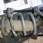 strut with attached compressor