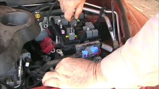 loosening the bolts chevy hhr fuse box removal yardzoo underhood fuse box removal on a 97 gmc 2500 at creativeand.co